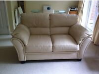 Cream leather 2 seater sofa