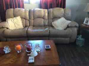 Leather sofa, reclines on both sides.  New condition.