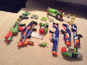 9 nerf guns with lots of darts, 3 targets, goggles