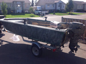 Camo couloured 14 foot aluminum boat with 25 Mercury motor