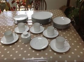 White dinner set with thin brown band by Thomas