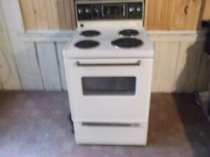 24 inch almond stove excellent working condition
