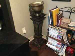 decorative glass bowl and iron pedestal