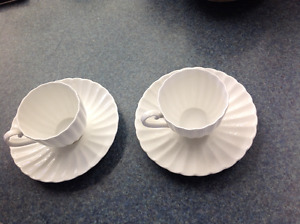 Two matching white Susie Cooper cup and saucer sets
