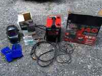 Lincoln Electric MIG-PAK 140 welder with helmet and gloves