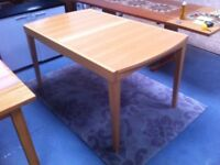 Tambour extending dining table