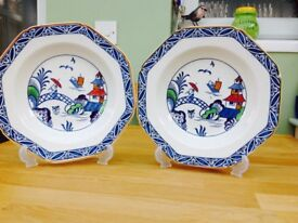 Pair of unusual west over plates