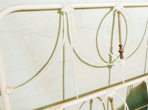Antique white iron bed with brass accents