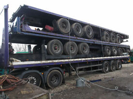 STACKS OF 5 TRI AXLE TRAILERS