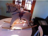 Nice Rocking horse, mamas and papas quality Item