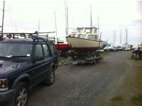 Boat services piggyback trailer diving moorings trailers servicing outboard inboard
