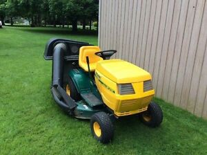 Riding mower with double bagger
