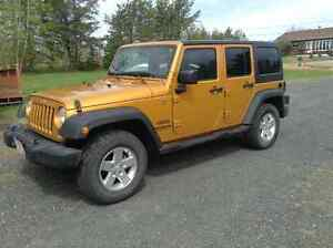 2014 Jeep Wrangler Unlimited...  New condition and babied!