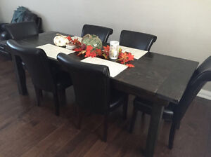 Harvest table and leather chairs