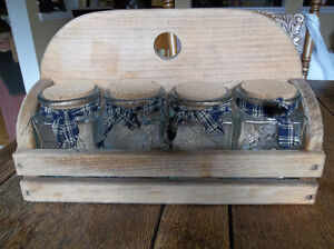Country style four jars with wood stand.