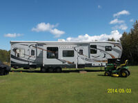 2011 Cyclone HD Toy Hauler Fifth Wheel Trailer For Sale