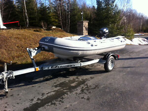 Brand new inflatable boat motor and trailer
