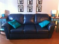 Navy blue leather couch and loveseat