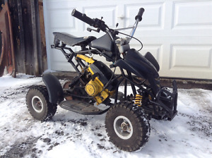 Mini quad/ pocket quad with chainsaw engine!