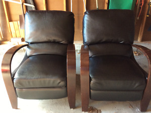 Two reclining bonded leather chairs. Black