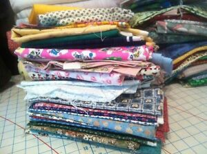 Fabric by the yard and large serger cones for sale