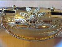 A beautiful gold ladies small bag with diamond £4