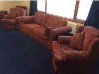 3 piece suite comprising 4 seater sofa and 2 matching arm chairs
