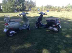 His and hers Vespa scooters