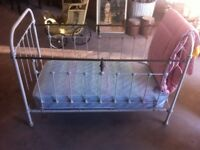 A French Victorian brass and iron cot
