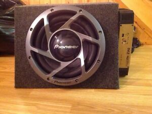 """Amp and 12"""" speaker with box."""
