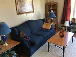 Chesterfield and chair coffe table and end tables with lamps it