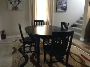 Wood Black dining room table and chairs
