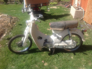 Selection of Honda 50s and parts for sale