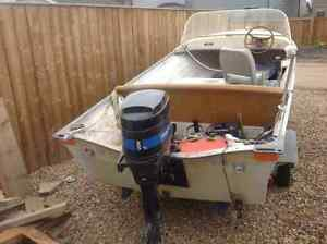 Sunray 14' fiberglass boat with 20hp motor for $2000