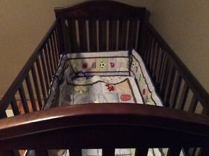 Beautiful crib for sale includes mattress and bedding.