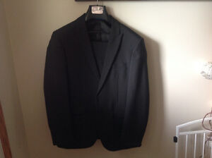 Emaculate Black two piece suit worn once.