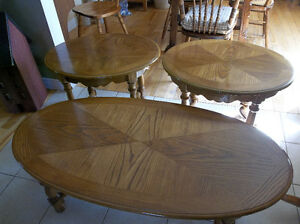 Three pieces wood coffee table set