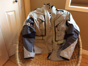 Motorcycle jacket, boots, gloves.