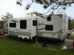 summer's on his way look at this camping trailer full equiped
