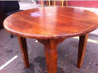 Rustic heavy pine circular dining table