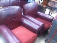 Pair of old leather armchairs