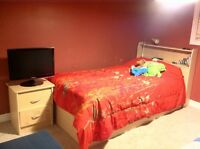 Beautiful twin bed with 3 storage draws and side table