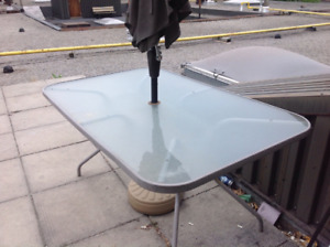 Patio table.  Glass