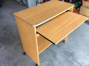 """DESK-29""""x 16"""" X 30""""high, with slide-out shelf, & on casters—$15"""