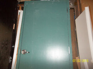 WOODEN DOOR IN A METAL BOX