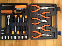 Assorted pliers and screwdrivers and ratchet