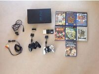 PlayStation 2 (PS2) includes 2 controllers, 3 memory cards, 7 games