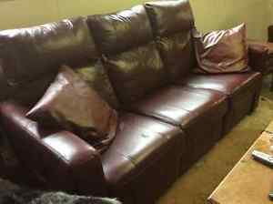 Cranberry red leather reclining couch and chair