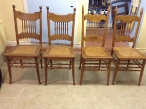 FOUR ANTIQUE OAK LADDER BACK CHAIRS
