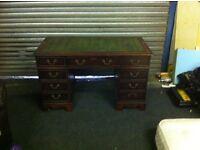 Pedestal kneehole desk